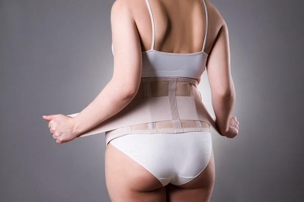 Dùng đai nịt bụng có giảm mỡ bụng không