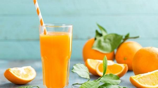 Uống nước cam giảm mỡ bụng